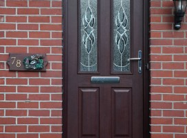 Ludlow composite door in Rosewood with Elegance glass and top light.