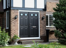 Black Tenby 2 composite door in French door style.