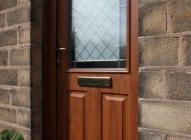Beeston composite door in Golden Oak with Brilliante glass.