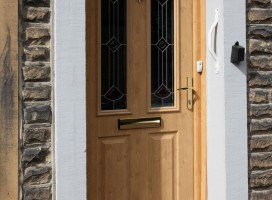 Ludlow 2 composite door and integrated top light in Irish Oak with Diamond glass.