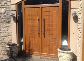 Bespoke French Windsor style composite doors in Golden Oak with 800mm handles, fitted in Selby.