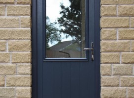 Bespoke Beeston composite door in Grey with clear glass.