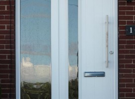 Brescia composite door in White with frosted Cotswold glass and integrated side panel.
