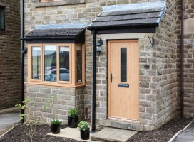 Flint 4 composite door in Irish Oak, Hade Edge