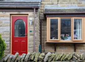 Stafford composite door in Red with Irish Oak frame and Red quad glass, Hade Edge