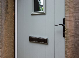 Flint 2 composite door in Painswick with white frame and catflap
