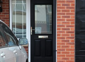 Beeston composite door in Black with White frame and integrated side light and Brilliante glass.